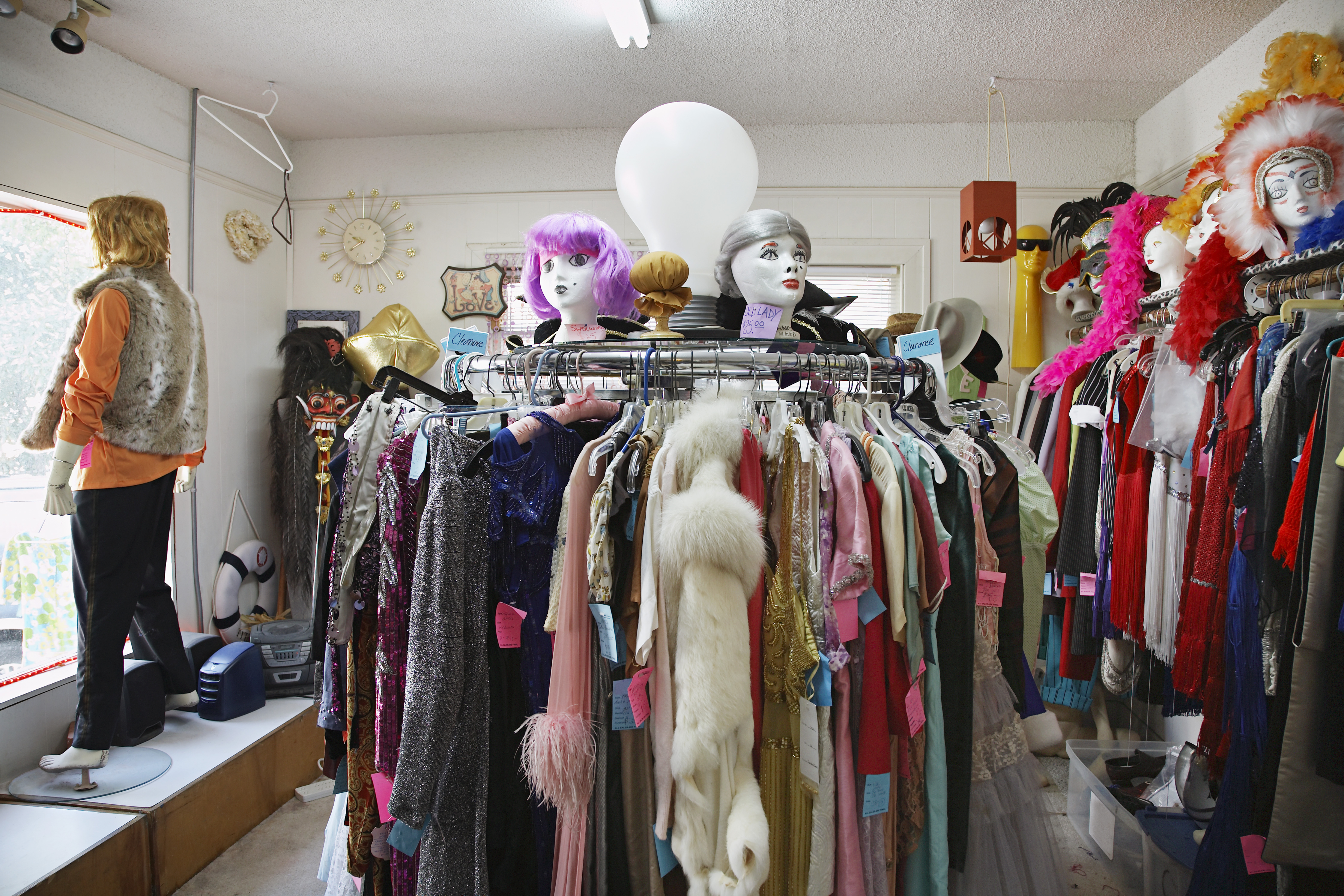 Clothing and wigs in crowded thrift store