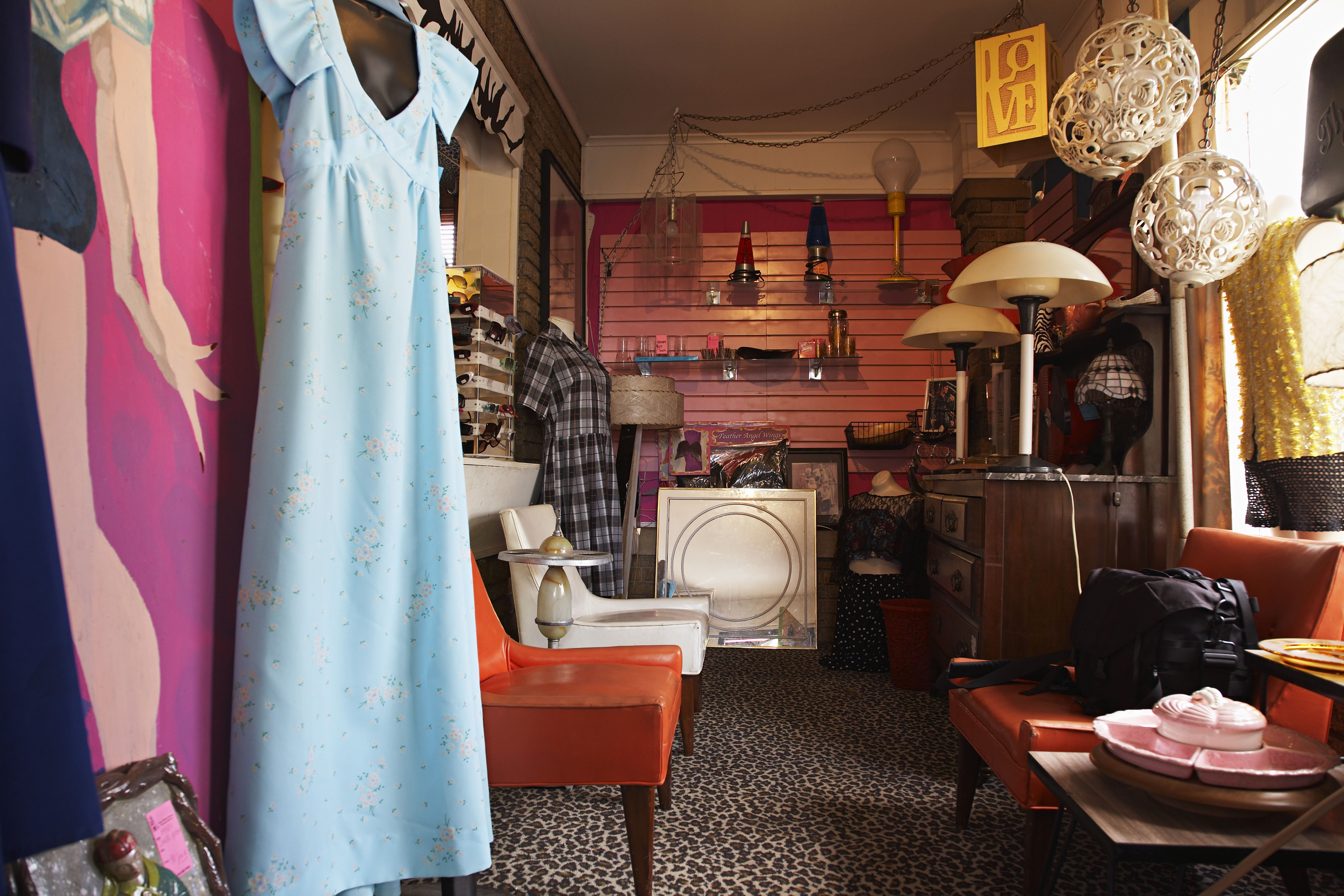Clothing and furniture in crowded thrift store