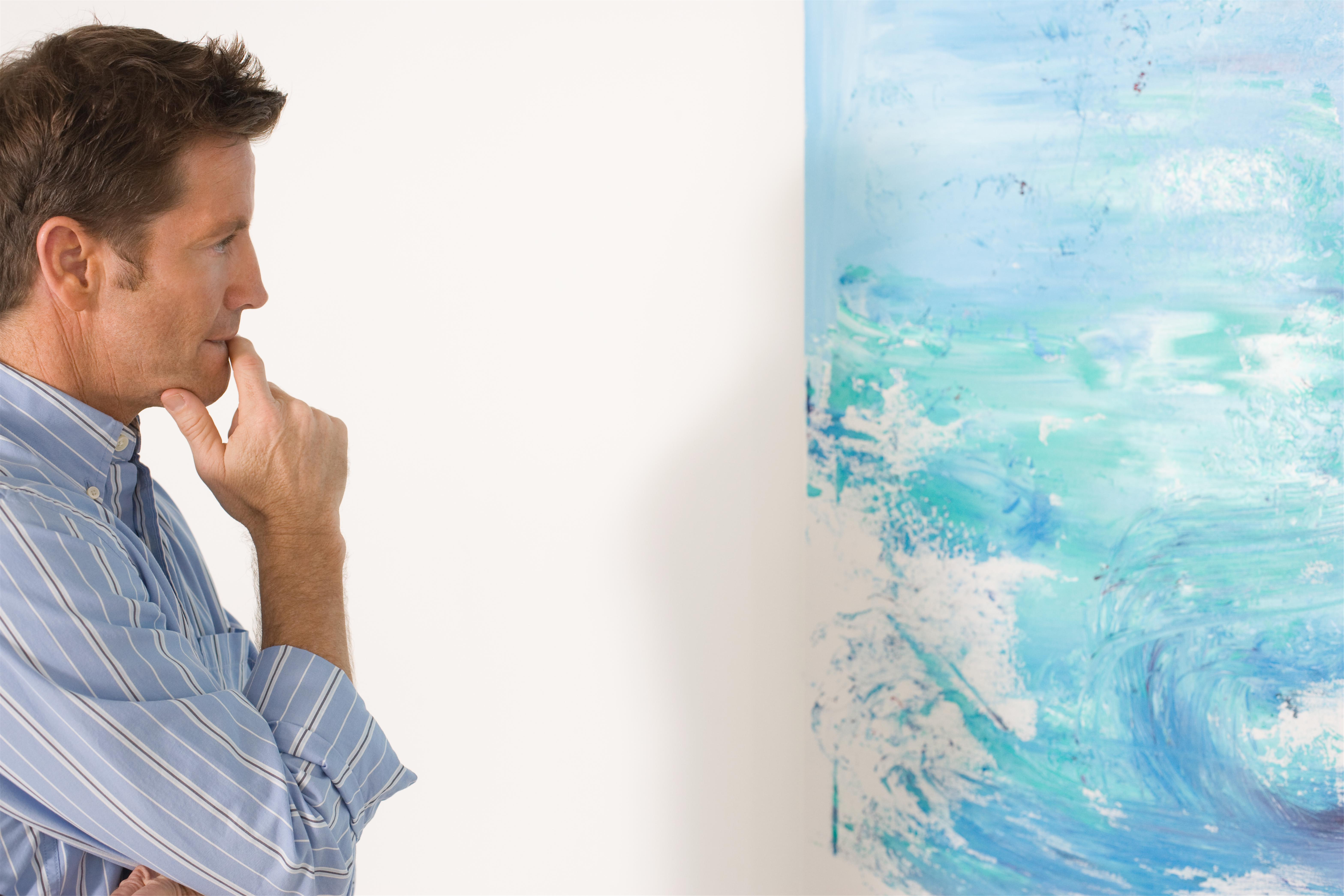 Man contemplating paintings in gallery 3