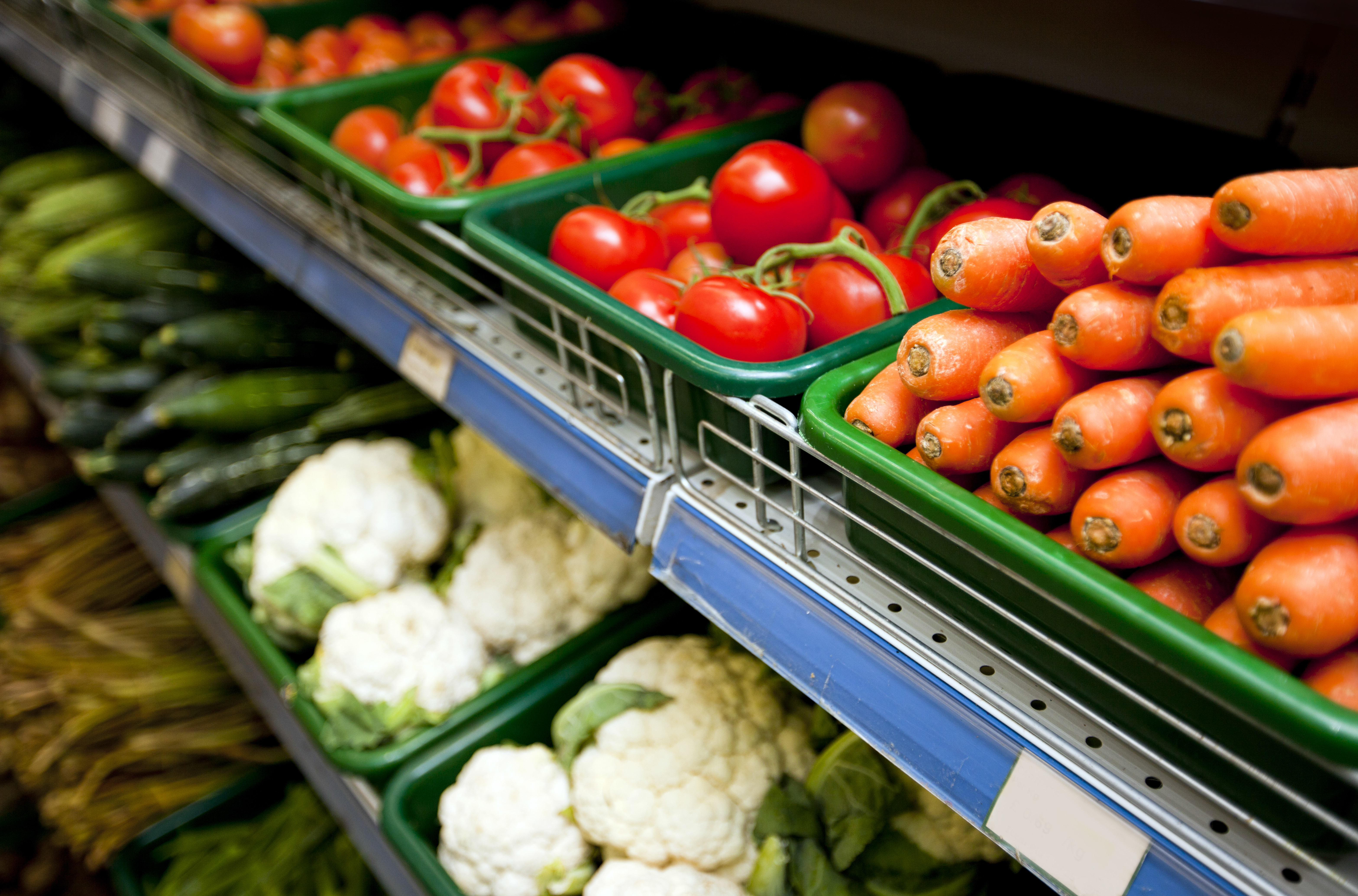 Various vegetables on display in specialty grocery store